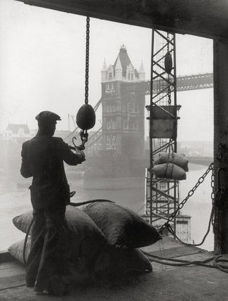 Pool of London Dockworker handling a cargo of bagged nuts 1947.jpg