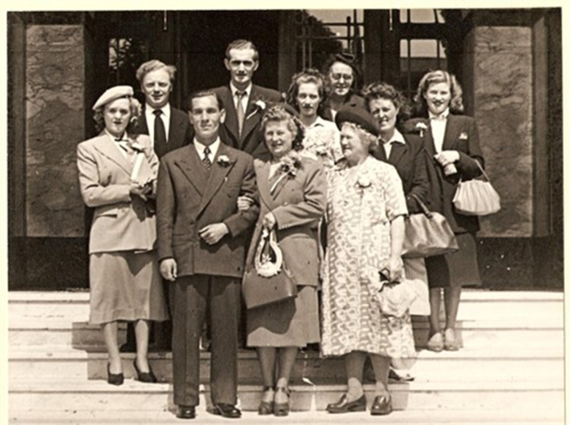Billy Oliver & Elsies Wedding.Mary left,George at back with Kathy in middle..png