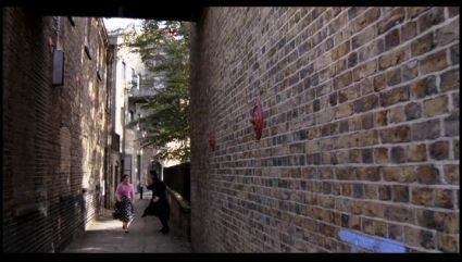 FILM A FISH CALLED WANDA 1980.Wanda and Otto come into view. Facing east on Rotherhithe Street as it runs between St. Marychurch Street and Elephant Lane in SE16. X.jpg