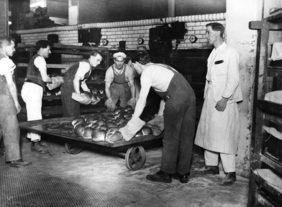 Spa Road, c1926, Fresh bread being taken out of an oven at the Bermondsey Co-operative's Bakery..jpg