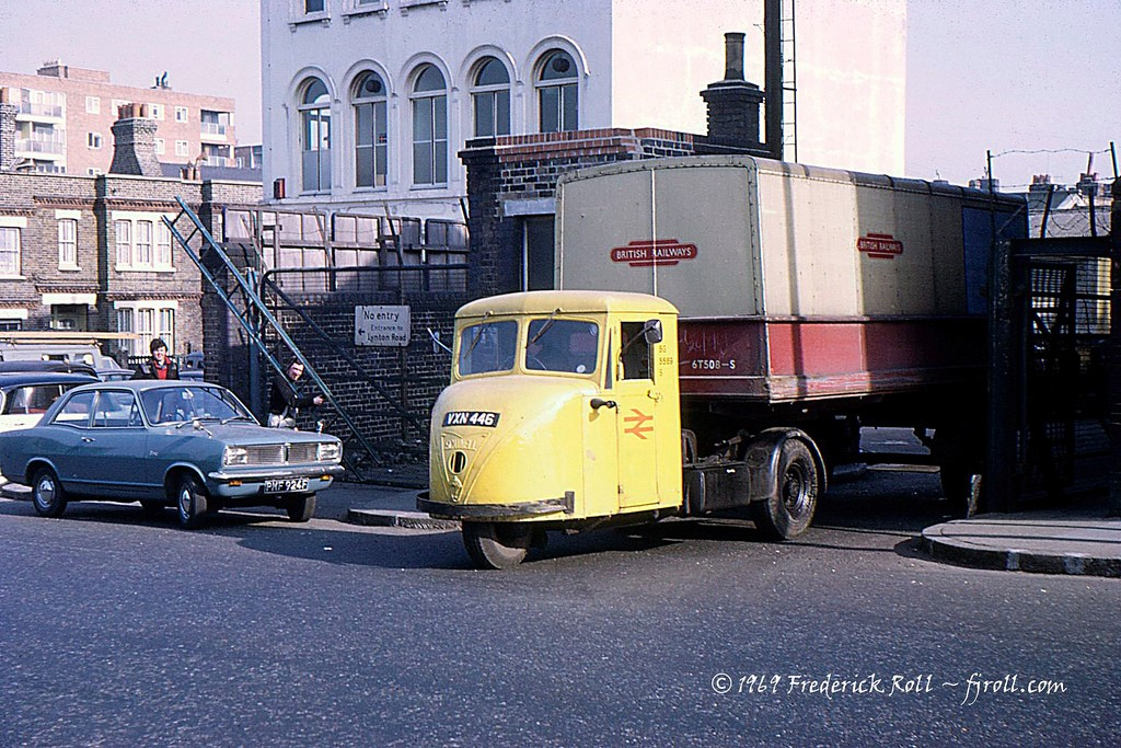 Dunton Road Exiting the British Rail goods yard is a Scammell Scarab and trailer. The junction with Lynton Road can be seen behind the Vauxhall Viva. 1969.jpg