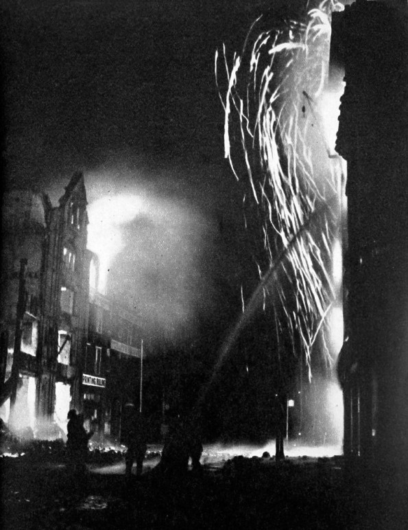 Fire fighting in Southwark on the night of 16th-7th April 1941..jpg