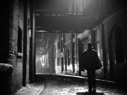 Clink Street looking west towards Southwark Bridge, Southwark. From the 1952 film The Hour 13..jpg