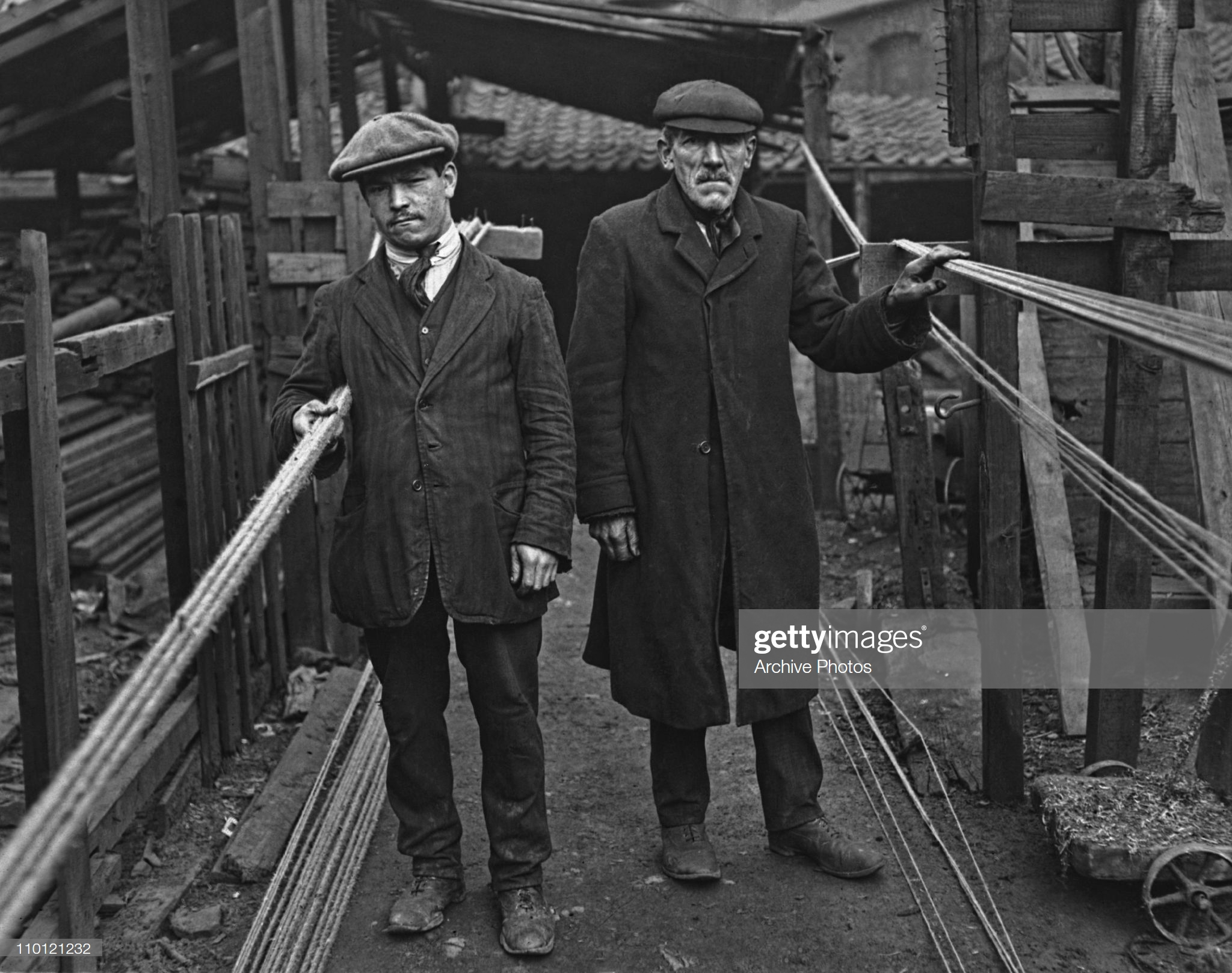 Tabard Street,Rope maker George Dryden (right) with his nephew on the ropewalk in Tabard Street, where they manufacture their products, circa 1920.  X.png