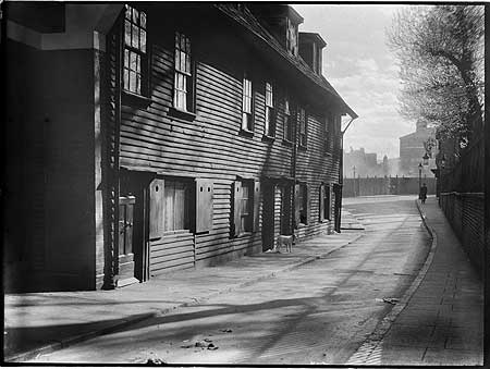 Columbo Street now Collingwood Street, looking south-west, showing weatherboarded cottages on the east side of the street  c1930s.   X.png