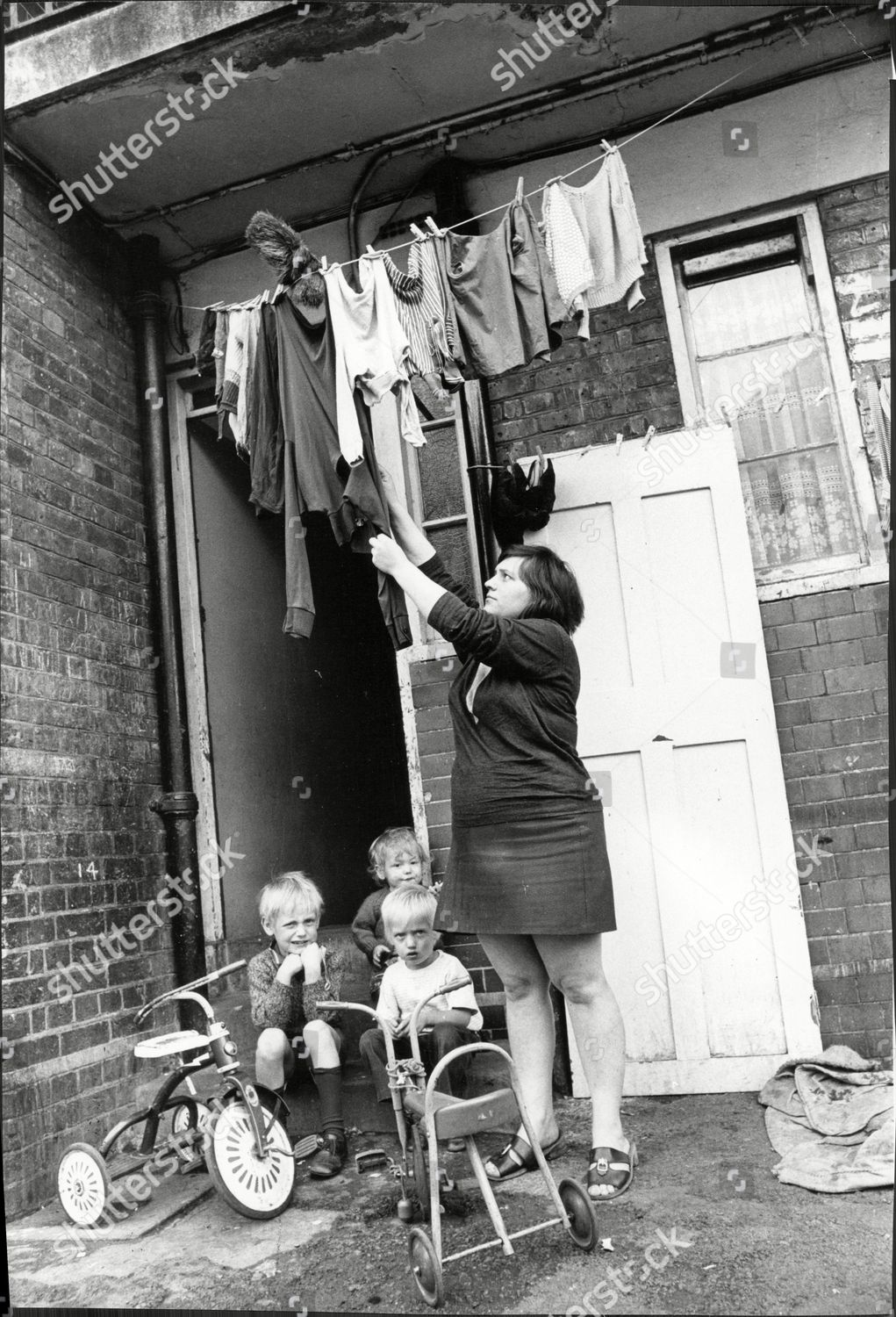 Tabard Street a mother and children outside their home at Chaucer House, Southwark c1971.  X.png
