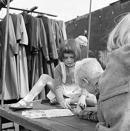 Bermondsey Antiques Market 1959-1965,children sitting on a table colouring.   X.png