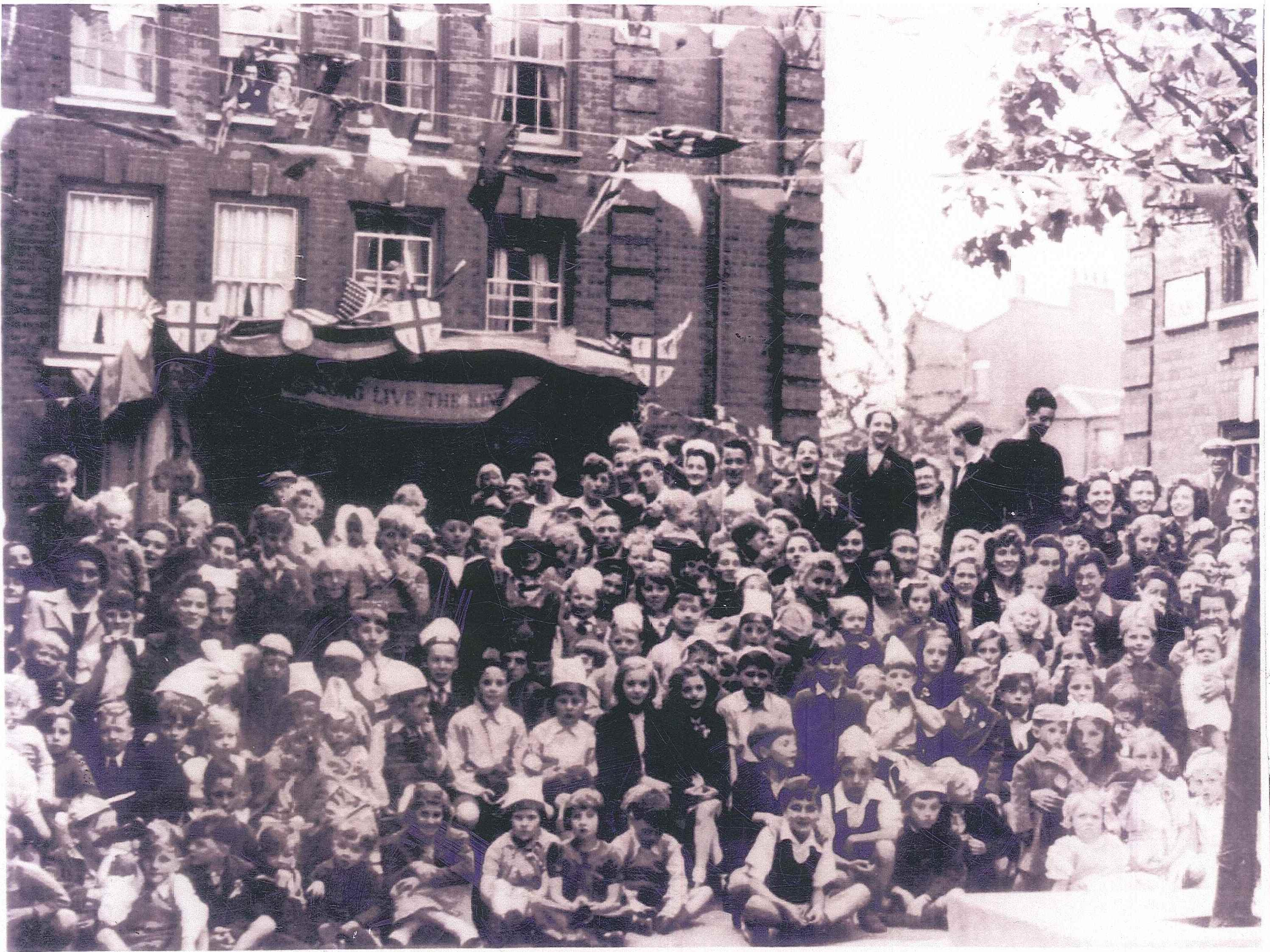 Plough Way Estate, C Block in Rotherhithe threw victory party. 1945.   2  X.jpg
