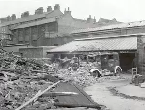 Blitz in London -- an AFS substation located in Webber Street, Southwark. with building debris covering fire appliances in the yard area.  X.png