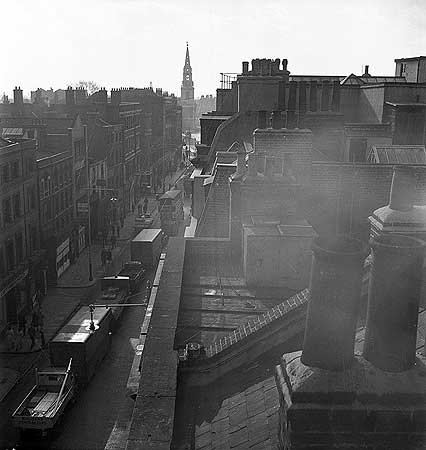 Borough High Street View from a rooftop, looking south along Borough High Street, with the spire of St George's Church in the distance.png