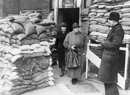 Two women leaving the Peacock Street school in Southwark, where they voted during World War II.  X.png